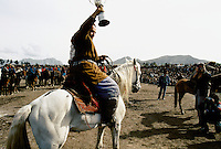 "The Winner in a Buzkashi between North East Afghans in the National stadium of Kabul..""bOzkashI"" is one of the ancient games played in Afghanistan. The name of this game is perhaps derived from hunting mountain goats by ancient champions n horseback."