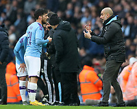 26th January 2020; Etihad Stadium, Manchester, Lancashire, England; English FA Cup Football, Manchester City versus Fulham; Manchester City manager Pep Guardiola gives tactical instructions to David Silva of Manchester City