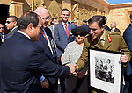 Egyptian President Abdel Fattah al-Sisi shakes hands with an officer in the company of Australian Governor-general Sir Peter Cosgrove at El Alamein War Cemetary, during a ceremony marking 75 years since the pivotal WWII battle in the Egyptian Mediterranean town of the same name, about 100 kilometres (62 miles) west of Alexandria on October 21, 2017. The World War II Battle of El Alamein -- which began on October 23, 1942 -- pitched the Allied forces of British Field Marshal Bernard Montgomery's against his German counterpart Erwin Rommel's Afrika Korps. Photo by Egyptian President Office