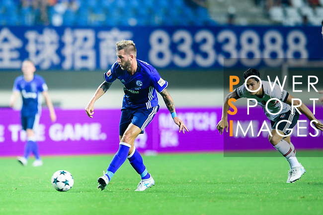 FC Schalke Forward Guido Burgstaller (L) in action during the Friendly Football Matches Summer 2017 between FC Schalke 04 Vs Besiktas Istanbul at Zhuhai Sport Center Stadium on July 19, 2017 in Zhuhai, China. Photo by Marcio Rodrigo Machado / Power Sport Images