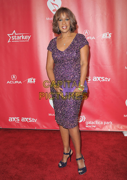 Gayle King.The MusiCares 2013 Person Of The Year Tribute held at The Los Angeles Convention Center, West Hall in Los Angeles, California, USA..February 8th, 2013.full length dress clutch bag purple beaded sequined sequins beads.CAP/RKE/DVS.©DVS/RockinExposures/Capital Pictures.