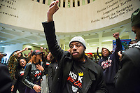TALLAHASSEE, FLA. 3/4/14-Elijah Armstrong of Bartow , center, leads the Dream Defenders in a chant during the opening day of the legislative session, March 4, 2014 at the Capitol in Tallahassee. The group wanted the legislature to know they continue to push for repeal of the stand your ground law.<br /> <br /> COLIN HACKLEY PHOTO