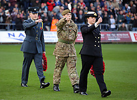 Members of the armed forces carry wreaths to the pitch during the Premier League match between Swansea City and Brighton and Hove Albion at The Liberty Stadium, Swansea, Wales, UK. Saturday 04 November 2017