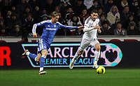 Pictured: Angel Rangel of Swansea (R) againstFernando Torres (L) of Chelsea. Tuesday, 31 January 2012<br />