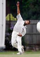 M Akram bowls for South Hampstead during the Middlesex County League Division Three game between South Hampstead and Ickenham at Milverton Road, Willesden Green on Saturday Aug 20, 2011