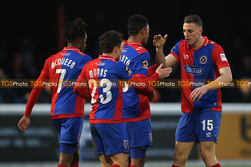 Angelo Balanta of Dagenham scores the third goal for his team and celebrates with his team mates during Dagenham & Redbridge vs Boreham Wood, Vanarama National League Football at the Chigwell Construction Stadium on 5th January 2019