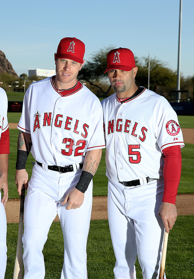 Feb. 21, 2113; Tempe, AZ, USA: Los Angeles Angels first baseman Albert Pujols (right) and outfielder Josh Hamilton pose for a portrait during photo day at Tempe Diablo Stadium. Mandatory Credit: Mark J. Rebilas-
