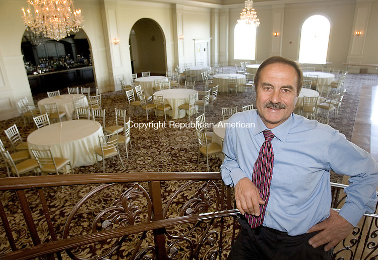 PROSPECT CT. 10 May 2013-051013S09-Joe Geloso Sr. stands on a staircase overlooking a grand ballroom at Aria Wedding and Banquet Facility in Prospect Friday. The new banquet facility will open soon..Steven Valenti Republican-American