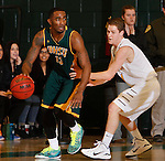 JANUARY 30, 2015 -- Myles Henry #13 of Black Hills State drives on Will Duggan #1 of Regis University during their Rocky Mountain Athletic Conference men's basketball game Friday evening at the Donald E. Young Center in Spearfish, S.D.  (Photo by Dick Carlson/Inertia)