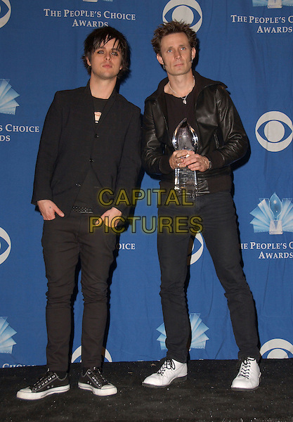 GREEN DAY - BILLIE JOE ARMSTRONG & MIKE DIRNT.The 32nd Annual People's Choice Awards held at The Shrine Auditorium in Los Angeles, California .January 10th, 2006.Ref: DVS.full length award trophy black jacket leather jeans trousers.www.capitalpictures.com.sales@capitalpictures.com.Supplied By Capital PIctures