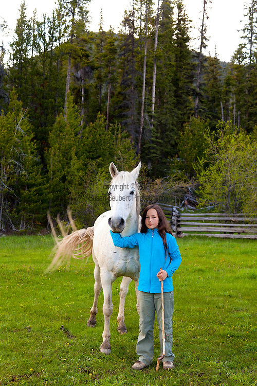 """Bracewells Alpine Wilderness Adventures located in the Chilcotin Districtof British Columbia. """"The Chilcotin"""" is a plateau and mountain region in British Columbia on the inland lea of the Coast Mountains on the west side of the Fraser River.  Horses in the pasture in front of the lodge."""