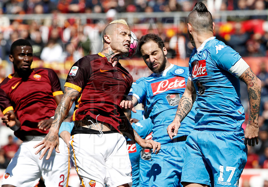 Calcio, Serie A: Roma vs Napoli. Roma, stadio Olimpico, 25 aprile 2016.<br /> Roma's Radja Nainggolan, second from left, Napoli's Gonzalo Higuain, second from right,  and Marek Hamsik fight for the ball during the Italian Serie A football match between Roma and Napoli at Rome's Olympic stadium, 25 April 2016. <br /> UPDATE IMAGES PRESS/Isabella Bonotto