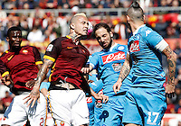 Calcio, Serie A: Roma vs Napoli. Roma, stadio Olimpico, 25 aprile 2016.<br /> Roma&rsquo;s Radja Nainggolan, second from left, Napoli&rsquo;s Gonzalo Higuain, second from right,  and Marek Hamsik fight for the ball during the Italian Serie A football match between Roma and Napoli at Rome's Olympic stadium, 25 April 2016. <br /> UPDATE IMAGES PRESS/Isabella Bonotto