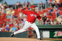Pitcher Jeffry Fernandez (37) of the Greenville Drive delivers a pitch in a game against the Rome Braves on Friday, June 12, 2015, at Fluor Field at the West End in Greenville, South Carolina. Greenville won, 10-8. (Tom Priddy/Four Seam Images)