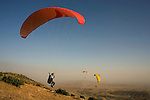 Ziad Abdulsattar lifts his feet when taking off with a paraglider with Falcon Aviation Club near Mosul, Iraq, June 10, 2010. Members of the club have watched the club's fortunes rise and fall with Iraq's, achieving a World Championship in paragliding in 1980 and losing nearly all their equipment when the club was looted after the 2003 invasion.