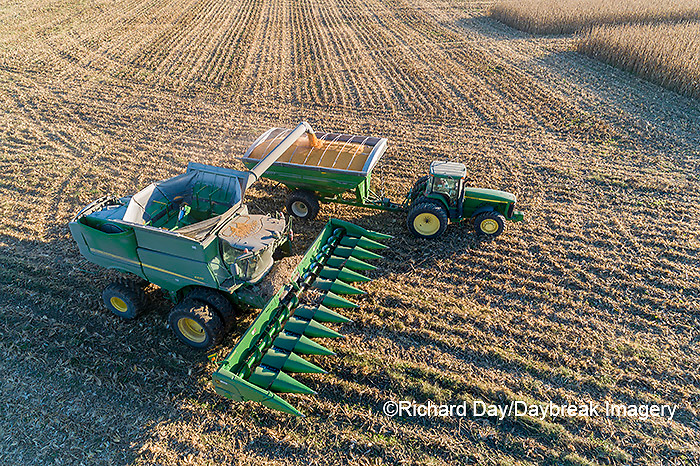 63801-13004 Harvesting corn and unloading into grain cart in fall-aerial  Marion Co. IL