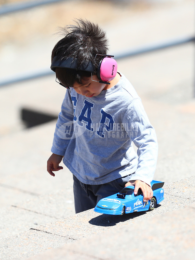 Jul 29, 2017; Sonoma, CA, USA; A young NHRA fan plays with a toy funny car during qualifying for the Sonoma Nationals at Sonoma Raceway. Mandatory Credit: Mark J. Rebilas-USA TODAY Sports