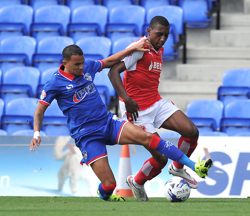 Fleetwood Town's Amari'i Bell battles with Oldham Athletic's Connor Brown<br /> <br /> Photographer Dave Howarth/CameraSport<br /> <br /> Football - The Football League Sky Bet League One - Oldham Athletic v Fleetwood Town - Saturday 15th August 2015 - SportsDirect.com Park - Oldham<br /> <br /> &copy; CameraSport - 43 Linden Ave. Countesthorpe. Leicester. England. LE8 5PG - Tel: +44 (0) 116 277 4147 - admin@camerasport.com - www.camerasport.com