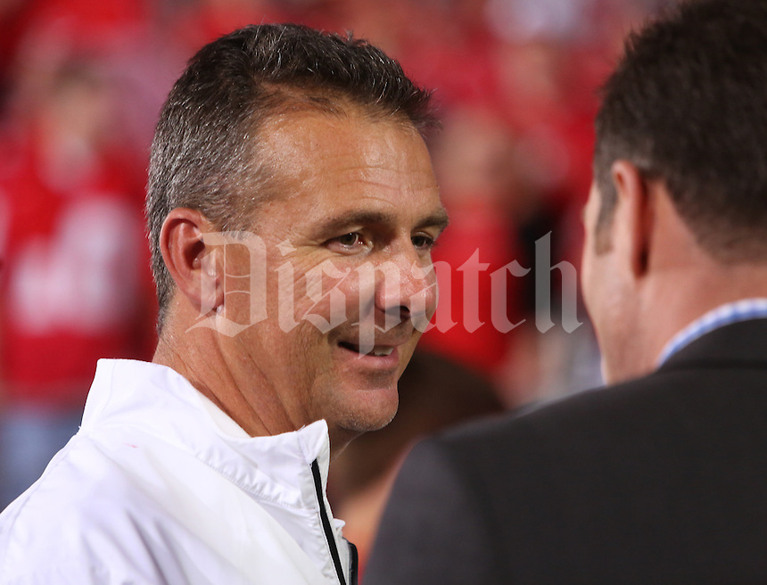 Ohio State University head football coach Urban Meyer is interviewed after a 31-24 win over Wisconsin in Saturday's NCAA Division I football game at Ohio Stadium in Columbus on September 28, 2013. (Barbara J. Perenic/Columbus Dispatch)