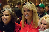 Trump campaign manager Kellyanne Conway poses for a photo with tourists in the lobby of Trump Tower in New York, NY, USA on December 3, 2016. <br /> Credit: Albin Lohr-Jones / Pool via CNP