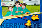 Sevan,Thomas and Daaiel O'Connor (Abbeydorney) catching a duck at the Abbeydorney Vintage Rally,on Sunday