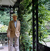 Portrait of Lord Snowdon with Panama hat and cane