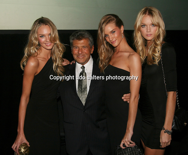 Victoria Secret Model Candice Swanepoel, Ed Resick of Victoria Secret, and Victoria Secret Models Rosie Huntington-Whiteley and Lindsay Ellingson attend the 12th Annual Collaborating For a Cure Dinner & Auction to benefit the Samuel Waxman Cancer Research Foundation at the Park Avenue Armory, November 18, 2009 .