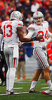 Ohio State Buckeyes kicker Drew Basil (24) and Ohio State Buckeyes quarterback Kenny Guiton (13) celebrate a successful PAT in the first quarter at Memorial Stadium in Champaign, Illinois on November 16, 2013.  (Chris Russell/Dispatch Photo)