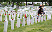 A U.S. Marine and a woman walk through the graves during Memorial Day activities at Arlington National Cemetery in Washington on Monday, May 27, 2013. .Credit: Joshua Roberts / Pool via CNP