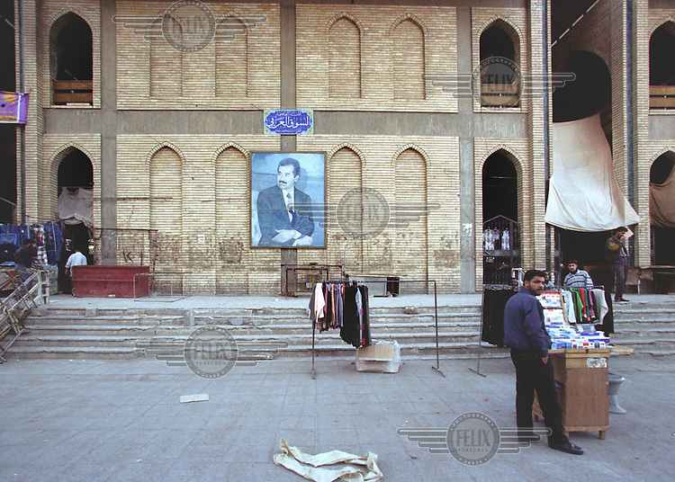 Daily life in the centre of Baghdad, while UN weapons inspectors  (February 1998) look for WMDs (weapons of mass destruction). Portrait of Saddam Hussein. The UNSCOM weapons inspectors left Iraq later that year.<br /> <br /> <br /> <br /> ©Fredrik Naumann/Felix Features