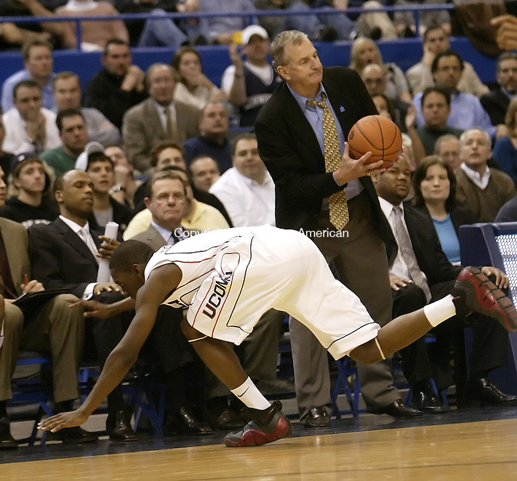 HARTFORD, CT, 01/17/08- 011708BZ14- UConn's Doug Wiggins (3) loses the ball while falling out of bounds as head coach Jim Calhoun catches the ball during their game against Providence at the XL Center in Hartford Thursday night.<br /> Jamison C. Bazinet Republican-American