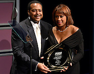 January 26, 2012  (Washington, DC)  KCBS-TV co-anchor Pat Harvey (right) receives her induction to the 2012 National Association of Black Journalists (NABJ) Hall of Fame, during a ceremony at the Newseum in Washington.  Leon Harris (left), of WJLA-TV in Washington, introduced Harvey.   (Photo by Don Baxter/Media Images International)