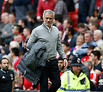 Jose Mourinho manager of Manchester United gets his coat and walks off at half time during the English Premier League match at the Old Trafford Stadium, Manchester. Picture date: May 21st 2017. Pic credit should read: Simon Bellis/Sportimage