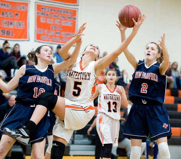 WATERTOWN, CT-011118JS07---Watertown's Jordyn Forte (5) reaches for a rebound between New Fairfield's Allison Teklits (10) and Danielle Hernandez (2) during their non-league game Thursday at Watertown High School.<br />  Jim Shannon Republican-American