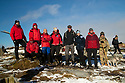 09/11/19<br /> <br /> Members of the Woodhead Mountain Rescue team.<br /> <br /> Surrounded by fresh overnight snow, hikers gather, in one of the remotest areas of the Derbyshire Peak District, for a two minute silence and to lay wreaths and crosses on the wreckage of an American RB29 bomber, known  as 'Over-Exposed' which crashed on Bleaklow Moor near Higher Shelf Stones, killing all thirteen crew in November 1948. Piles of twisted metal have been piled up to form a makeshift memorial that lies next to whole engines, pieces of fuselage, wings, wheels and other twisted parts of aluminium that have lain on the moors for  71 years.<br /> <br /> Today prayers were said, a harmonica player performed the Last Post and Taps (the US equivalent) and members of the Woodhead Mountain Rescue teams remembered their forbears who were first to arrive at the crash scene after the bomber descended in low cloud hitting the high peak.<br /> <br /> All Rights Reserved: F Stop Press Ltd.  <br /> +44 (0)7765 242650 www.fstoppress.com
