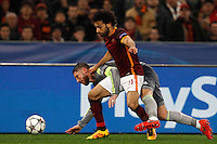 Calcio, andata degli ottavi di finale di Champions League: Roma vs Real Madrid. Roma, stadio Olimpico, 17 febbraio 2016.<br /> Real Madrid's Sergio Ramos, left, and Roma's Mohamed Salah fight for the ball during the first leg round of 16 Champions League football match between Roma and Real Madrid, at Rome's Olympic stadium, 17 February 2016.<br /> UPDATE IMAGES PRESS/Riccardo De Luca