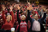NWA Democrat-Gazette/CHARLIE KAIJO Arkansas Razorbacks head coach Mike Anderson (right) and his wife Marcheita Anderson (center) call the hogs during the NCAA selection show, Sunday, March 11, 2018 at Bud Walton Arena in Fayetteville. The Razorbacks will play Butler in Detroit on Friday