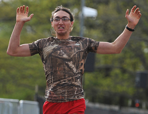 Peter Notarnicola, 23, of Massapequa reacts after winning the inaugural 1-mile race as part of Long Island Marathon Weekend at Eisenhower Park on Saturday, May 5, 2018.