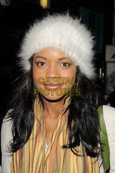 NAOMIE HARRIS.'The Jungle Book' gala performance.Bloomsbury Theatre, London, England.22nd December 2008.portrait headshot white fur hat yellow striped scarf  hoop earrings.CAP/CAN.©Can Nguyen/Capital Pictures.