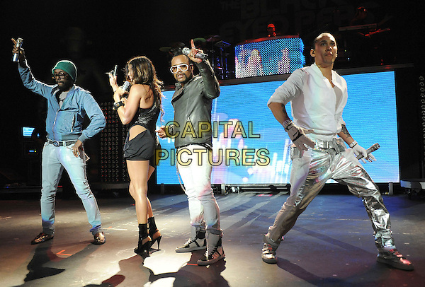 BLACK EYED PEAS - Will.i.am (William James Adams, Jr.), Fergie (Stacy Ferguson), Apl.de.ap (Allan Pineda Lindo) & Taboo (Jaime Luis Gómez).Black Eyed Peas perform live at The Pacific Ampitheatre in Costa Mesa, California, USA, August 7th 2009  .music concert on stage gig performing  BEP full length group silver black white shirt trainers shiny trousers shorts playsuit zip bustier costume heels booties ankle boots leather jacket hands on hips buckles                                                   .CAP/DVS.©DVS/RockinExposures/Capital Pictures