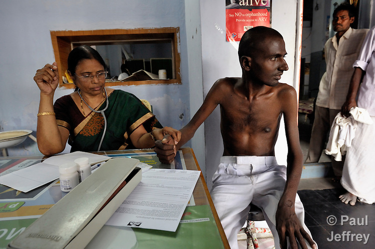 Dr. Lalitha of the National Lutheran Health and Medical Board examines SK Baji, a man living with HIV, while visiting a clinic in Chilakaluripet, a town in Andhra Pradesh, India. (Note Special Instructions below.)