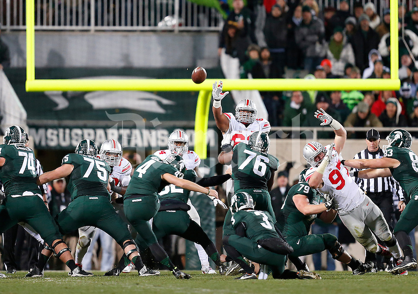 Michigan State Spartans place kicker Michael Geiger (4) misses a field goal in the second quarter of the college football game between the Ohio State Buckeyes and the Michigan State Spartans at Spartan Stadium in East Lansing, Saturday night, November 8, 2014. As of half time the Ohio State Buckeyes led the Michigan State Spartans 28 - 21. (The Columbus Dispatch / Eamon Queeney)