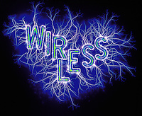 Graphic image - the word 'Wireless' spelled out in neon lettering on a field of blue energy plasma..