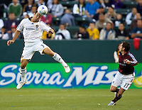 LA Galaxy defender Greg Vanney heads a ball past Rapids midfielder Terry Cooke. LA Galaxy defeated the Colorado Rapids 3-2 at Home Depot Center stadium in Carson, California on Sunday October 12, 2008. Photo by Michael Janosz/isiphotos.com