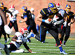 BROOKINGS, SD - OCTOBER 22:  Dallas Goedert #86 from South Dakota State University slips the grasp of Jameel Smith #26 from Youngstown State in the first half of their game Saturday afternoon at Dana J. Dykhouse Stadium in Brookings. (Photo by Dave Eggen/Inertia)