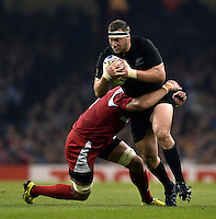 Wyatt Crockett of New Zealand is tackled in possession. Rugby World Cup Pool C match between New Zealand and Georgia on October 2, 2015 at the Millennium Stadium in Cardiff, Wales. Photo by: Patrick Khachfe / Onside Images
