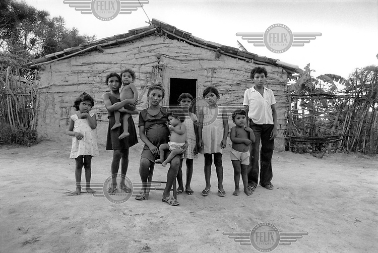 Paul Harrison / Panos Pictures..BRAZIL..Pregnant mother and her eight children. Their father has left for another woman.