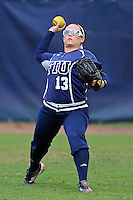 11 February 2012:  FIU's Alex Casals (13) throws the ball from the outfield during pre-game drills as the University of Louisville Cardinals defeated the FIU Golden Panthers, 4-2, as part of the COMBAT Classic at the FIU Softball Complex in Miami, Florida.