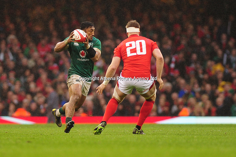Pictured: Bundee Aki of Ireland in action during the Guinness six nations match between Wales and Ireland at the Principality Stadium, Cardiff, Wales, UK.<br /> Saturday 16 March 2019