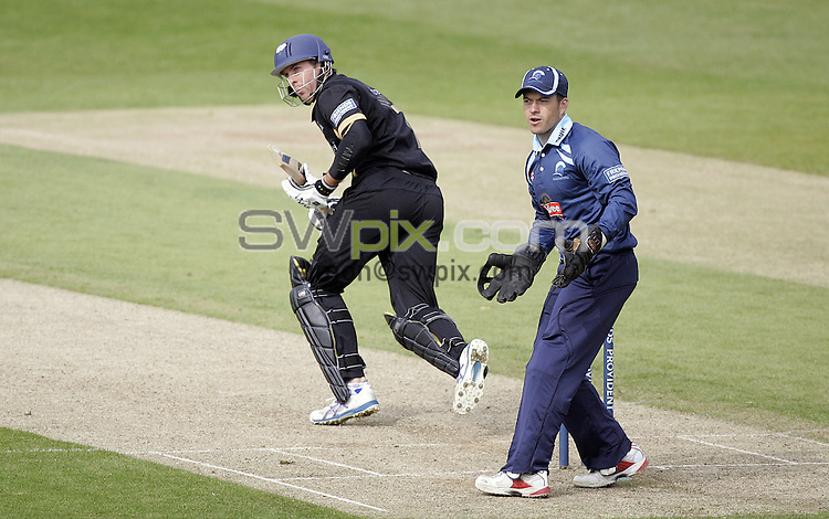PICTURE BY VAUGHN RIDLEY/SWPIX.COM - Cricket - Friends Provident Trophy - Yorkshire v Gloucestershire - Headingley, Leeds, England - 03/05/09...Copyright - Simon Wilkinson - 07811267706...Yorkshire's Michael Vaughan and Gloucestershire's Steve Adshead.